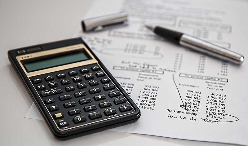 A business calculator shows fraud risk.
