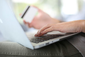 How can using a prepaid reloadable debit card help reduce fraud?