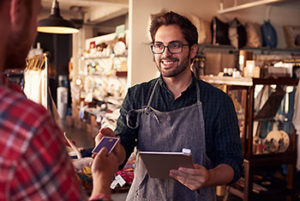 How do small business debit cards differ from business credit cards?